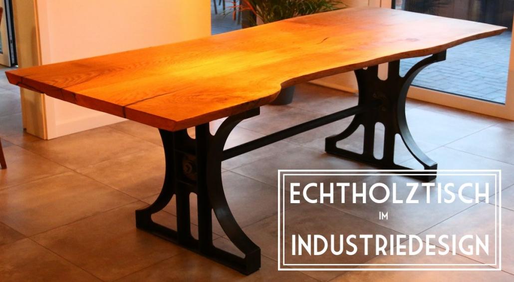 Esstisch im Industriedesign mit Baumkante